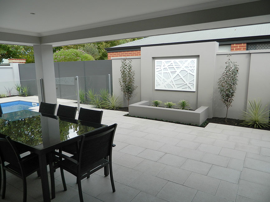 Patio with table and chairs on grey concrete pavers
