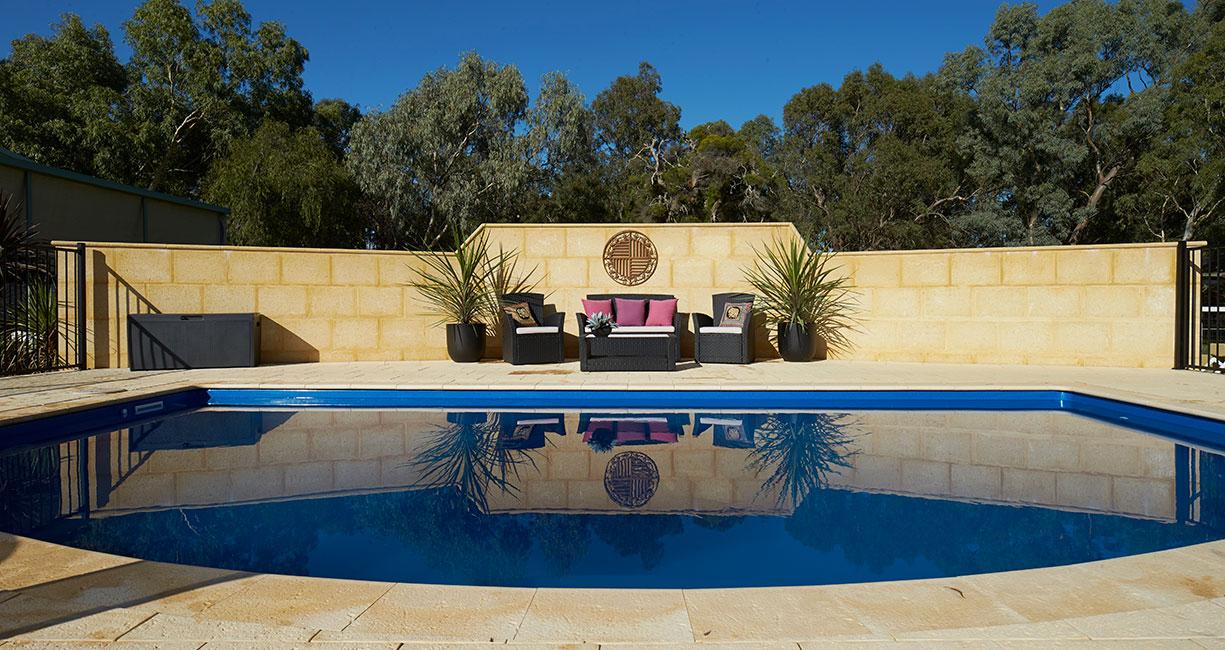 limestone retaining wall in backyard